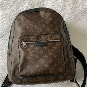Louis Vuitton Monogram book bag.